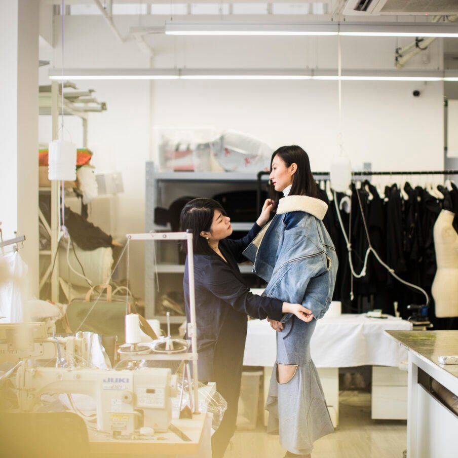 Masha Ma tests out clothing on a model at her studio in Shanghai, China.