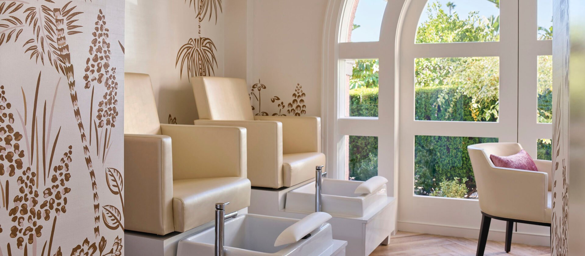Nail Suite with two plush chairs and arched window