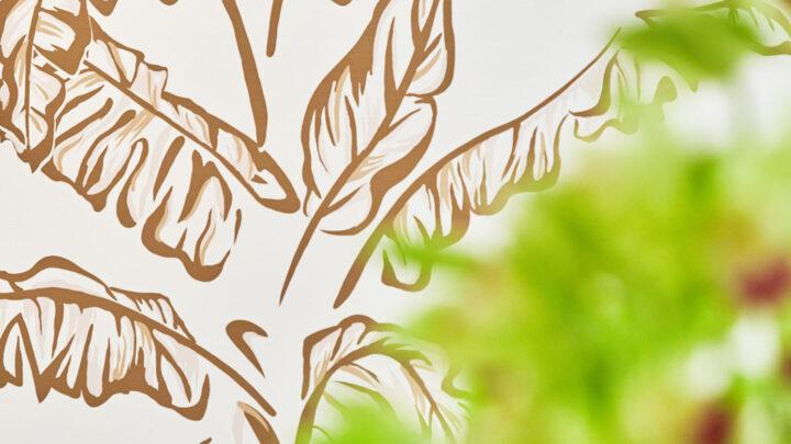 CLose up detail of spa gold botanical pattern wallpaper