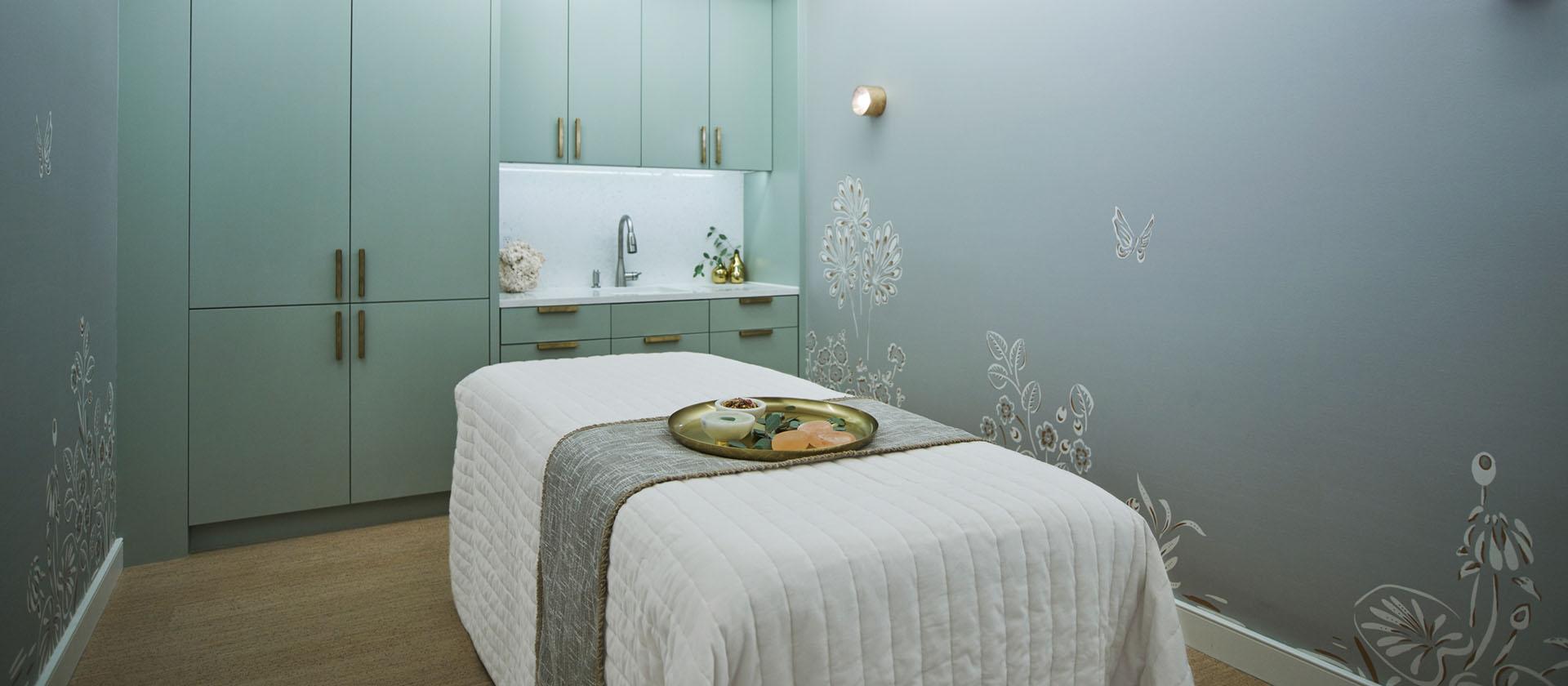 Serene treatment room set up with custom blue wallpaper