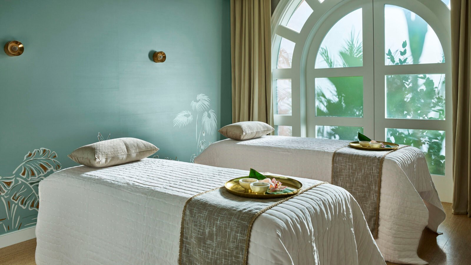 Duet Suite with custom blue walls, natural light and two plush beds