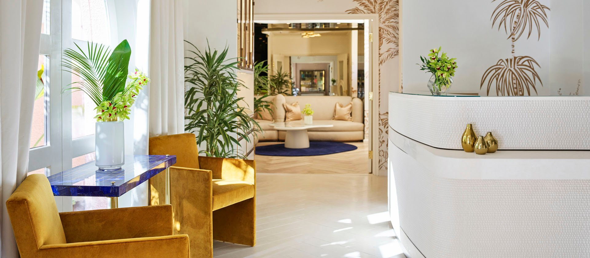 Spa reception entrance with natural light and gold pattern wallpaper