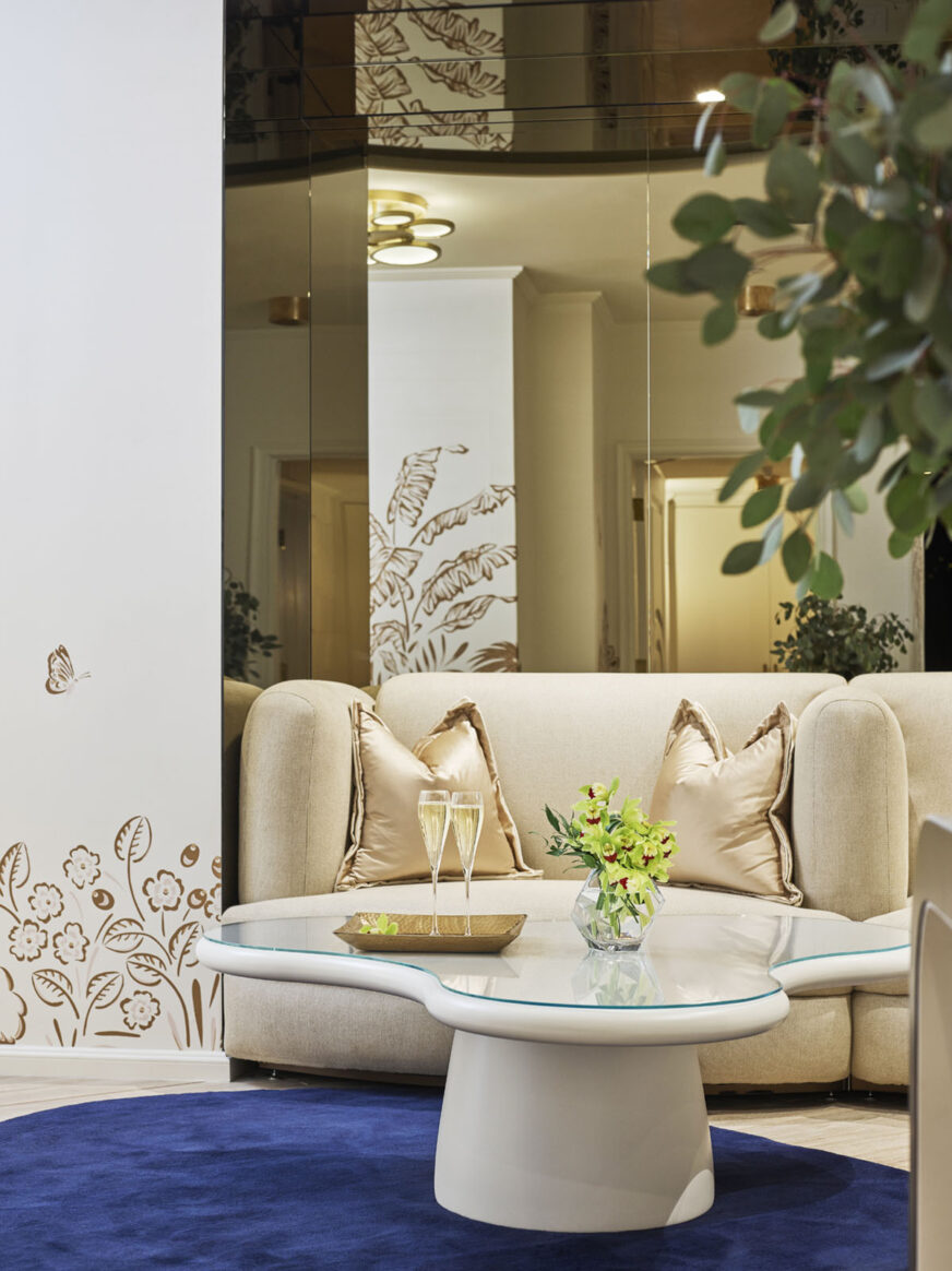 Corner sofa in spa with champagne toast set up