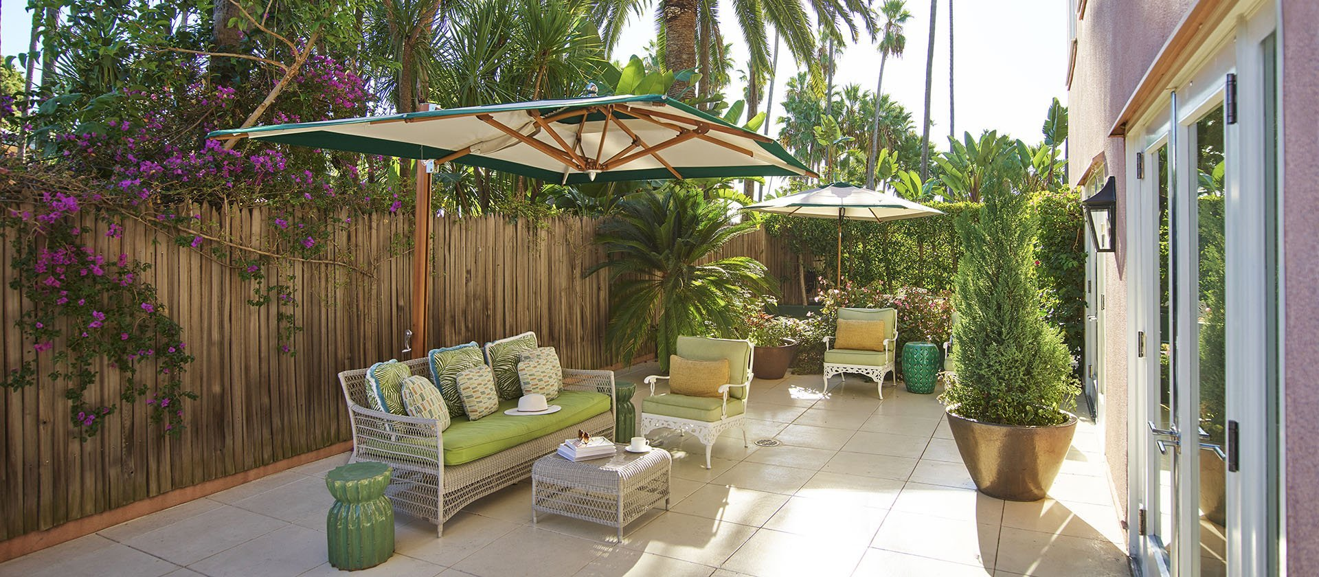 Patio with outdoor furniture and tropical plants