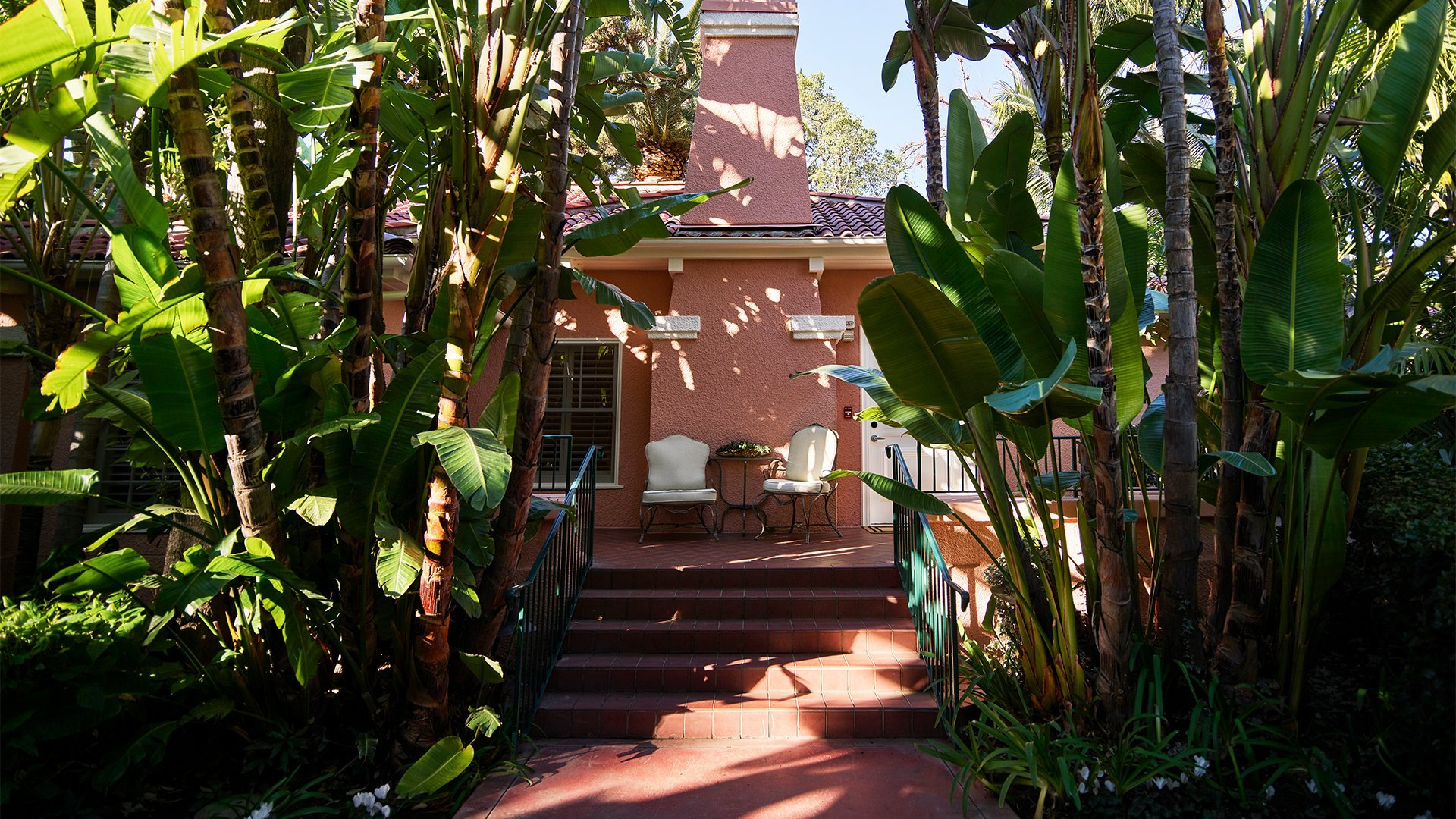 Bungalow entrance with greenery surrounding