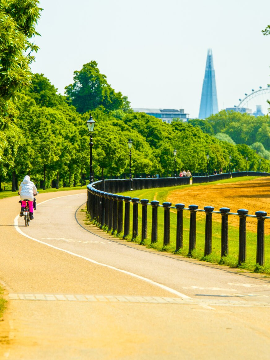 Beautiful path in the Hyde park in London with a Shard skyscraper on the horizon-shutterstock 568702429