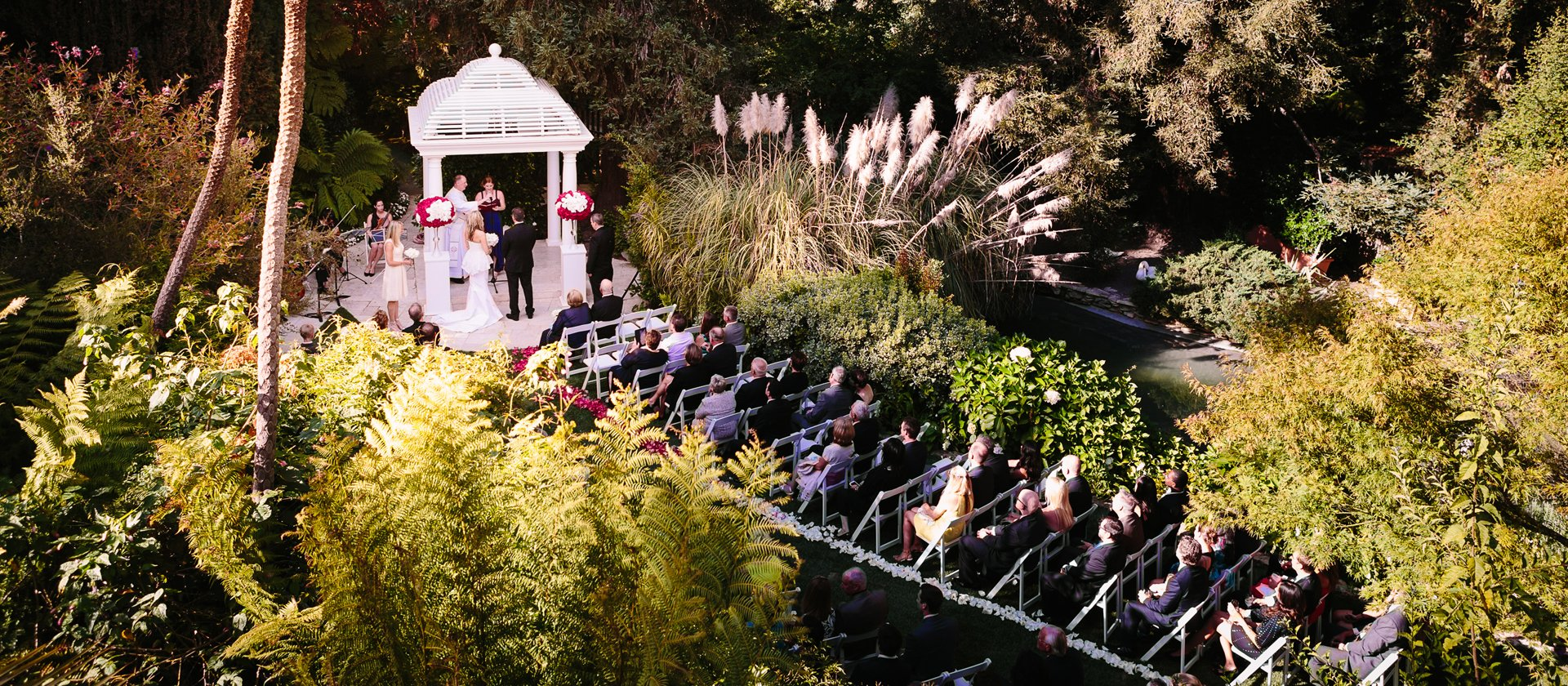 wedding guests seated at swan lake reception by Brian Leahy