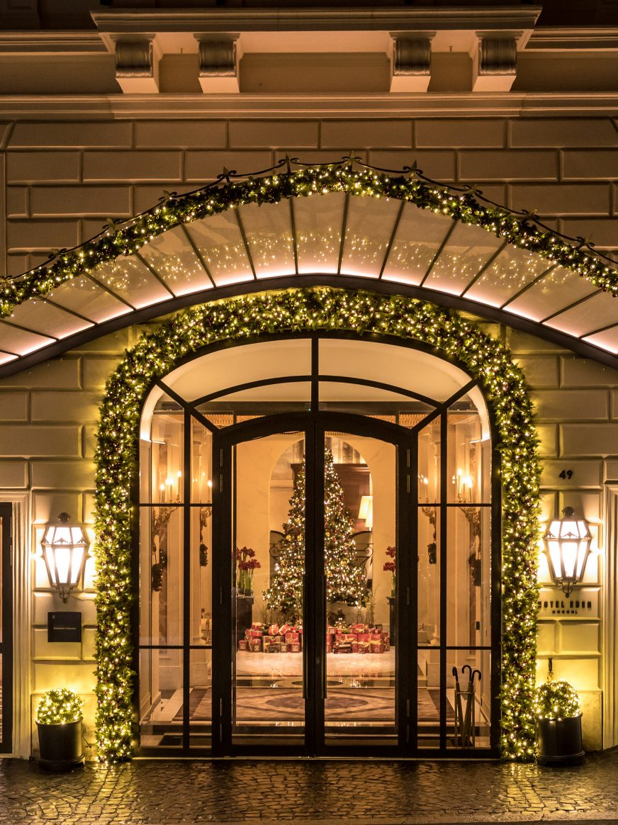 The entrance of Hotel Eden in Rome with Christmas decorations on the exterior