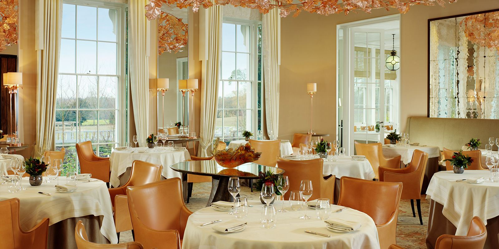 Restaurant Coworth Park, with its relaxed elegance and contemporary setting overlooking parkland views, puts its own modern spin on classic British dishes.