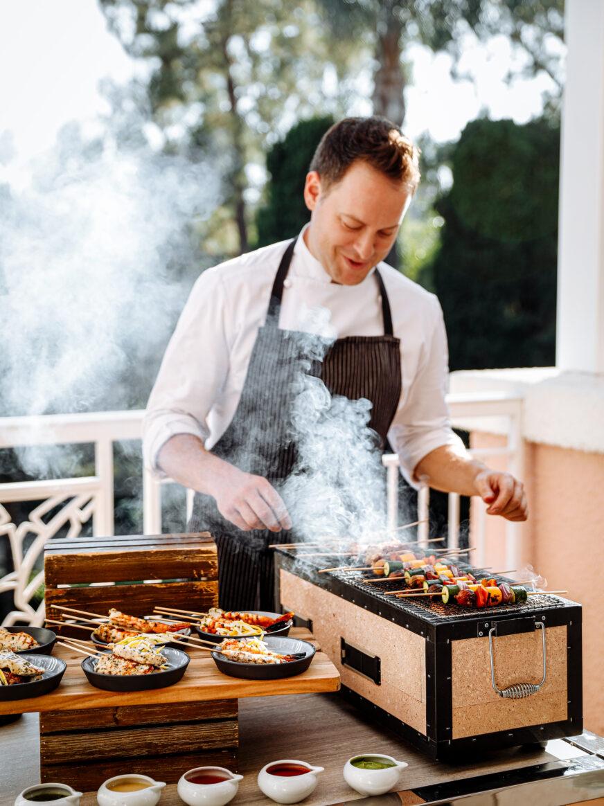 Chef Santoro grilling vegetables poolside