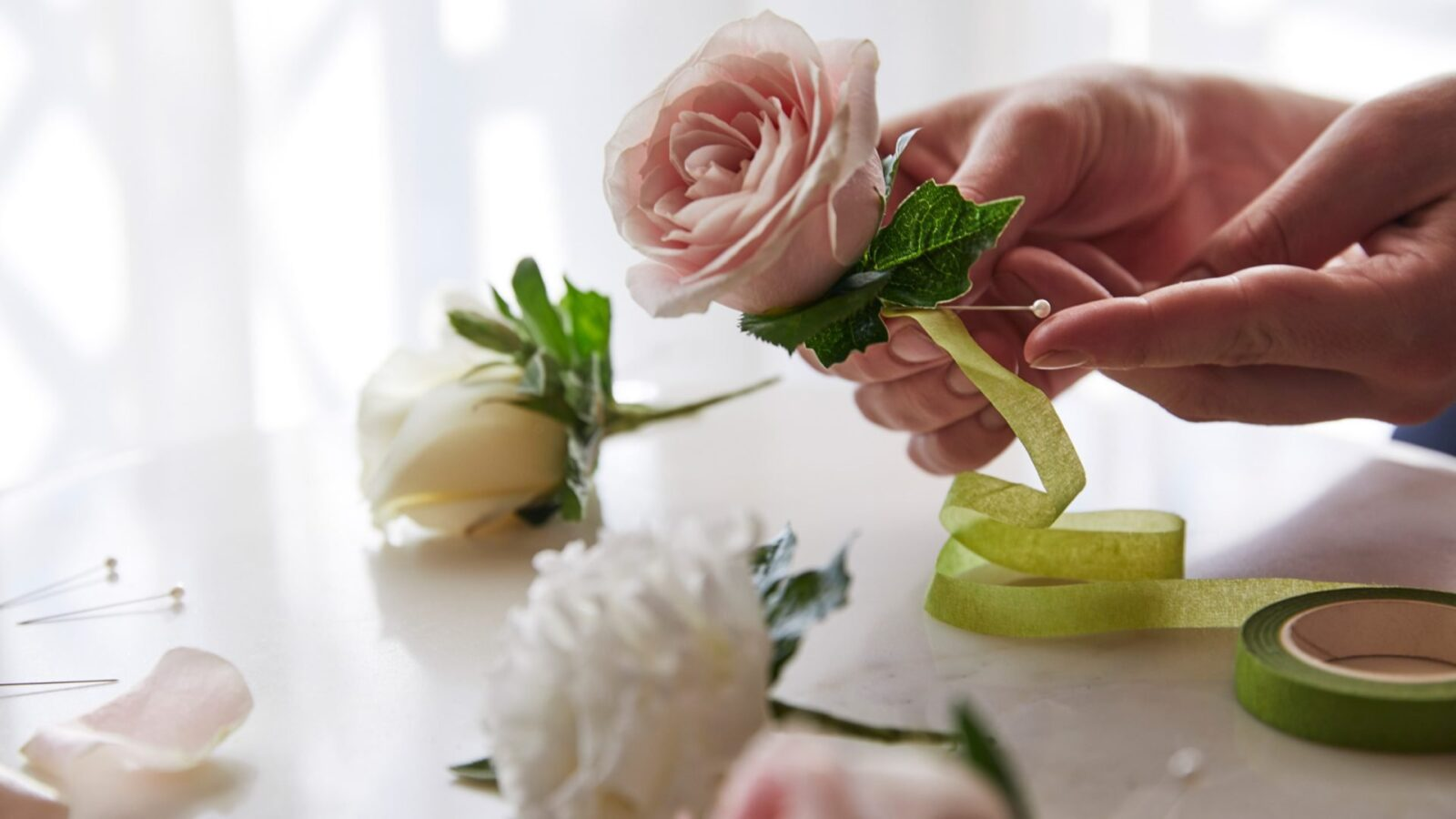 summer at the dorchester buttonhole bar with florist and flowers
