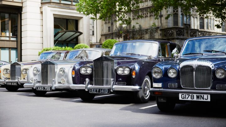 Classic car fleet parked outside The Dorchester