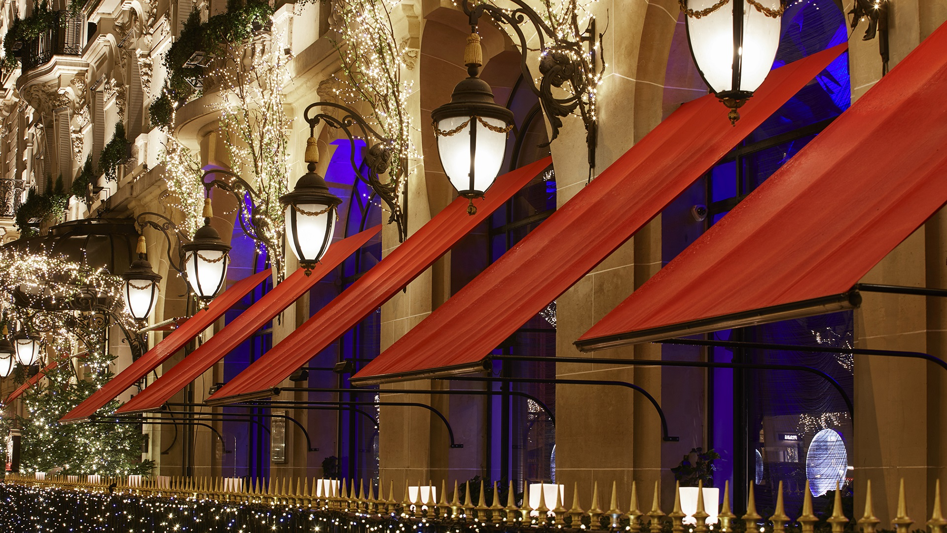 picture of the facade with red blind and festive lights