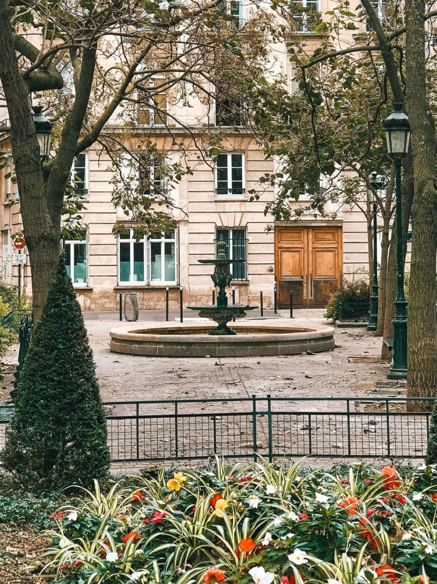 Picture of the place de l'escapade in Paris with a fountain in the middle.