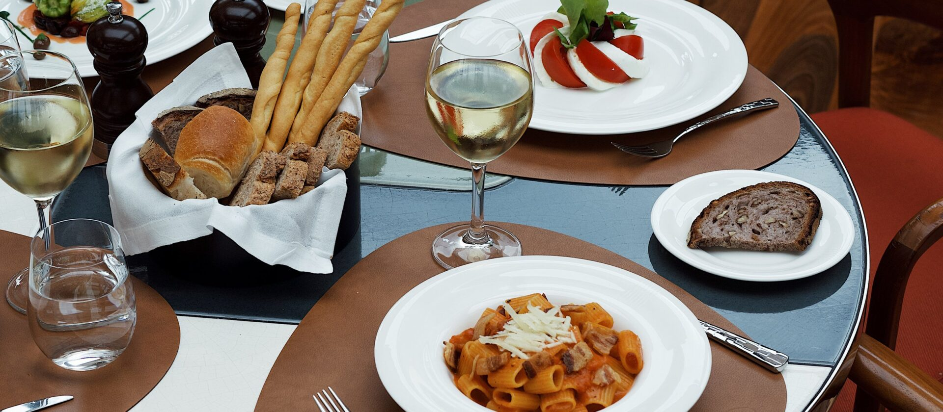 Milanese food on a table including pasta, bread and cheese dishes