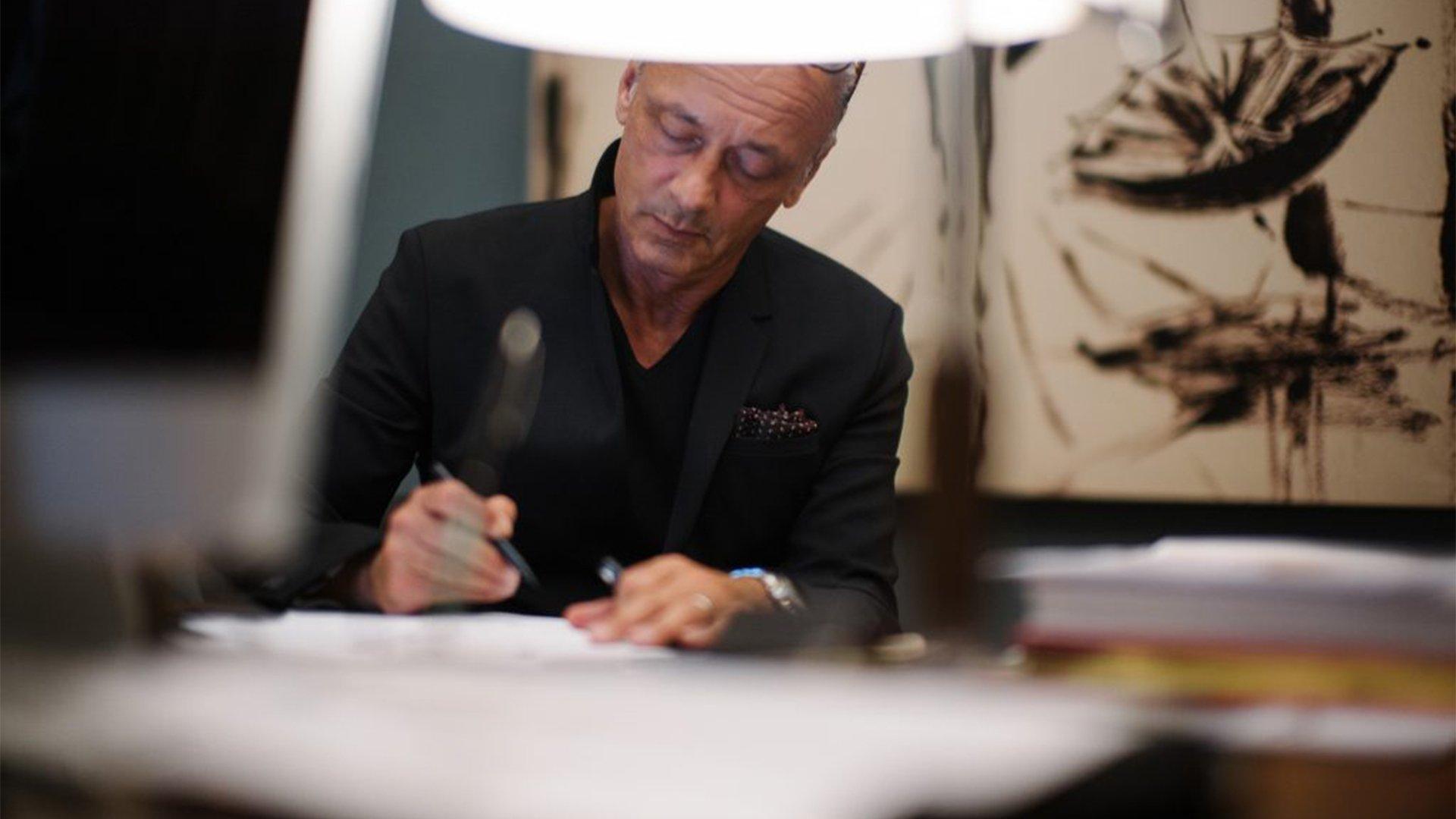 Italian Illustrator Andrea Ferolla doing a drawing