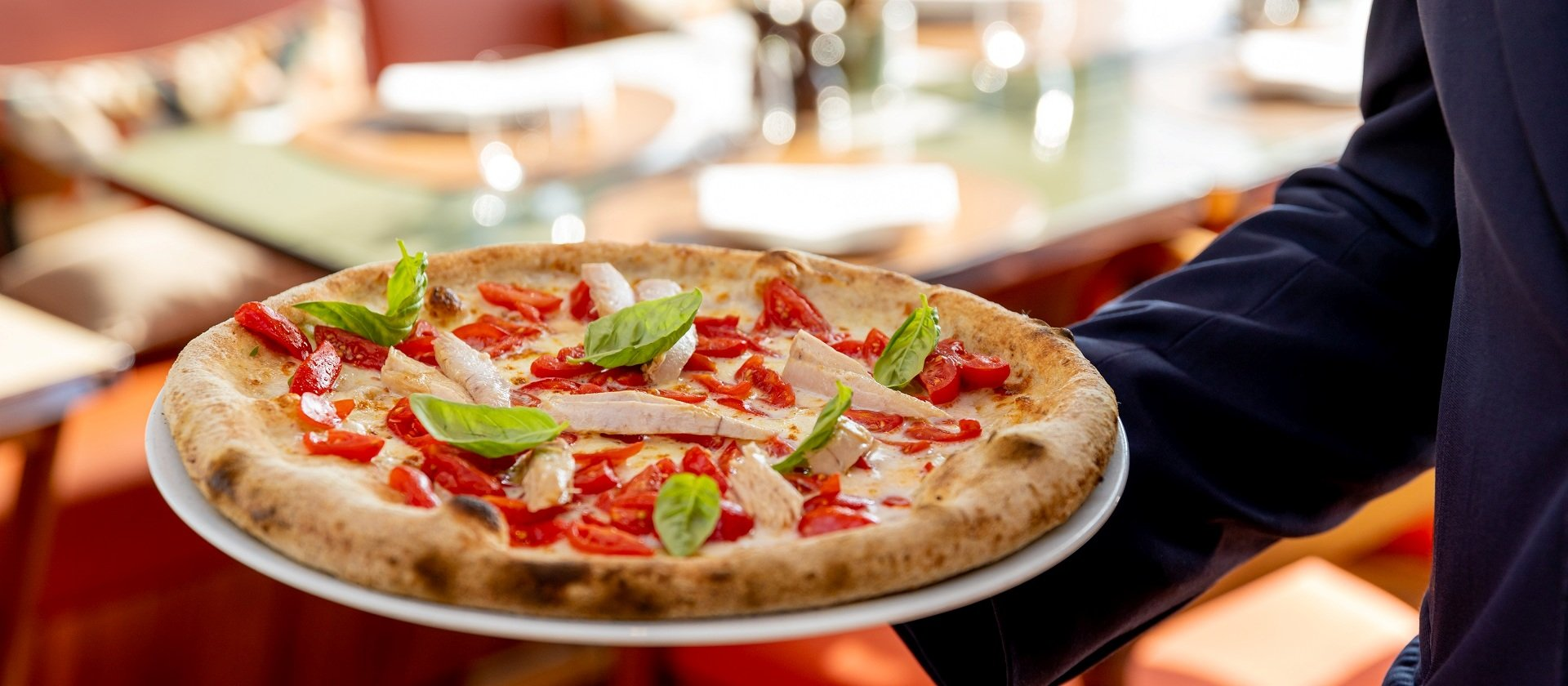 Hoven baked pizza with tuna and tomates served at Il Giardino Ristorante