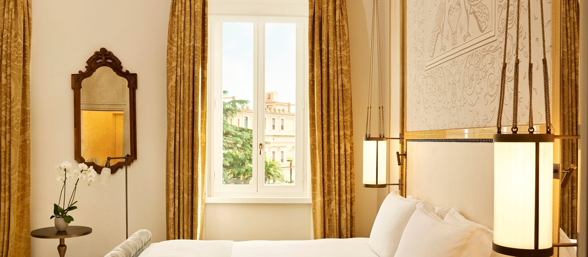 Inside a bedroom at Hotel Eden with views of Rome