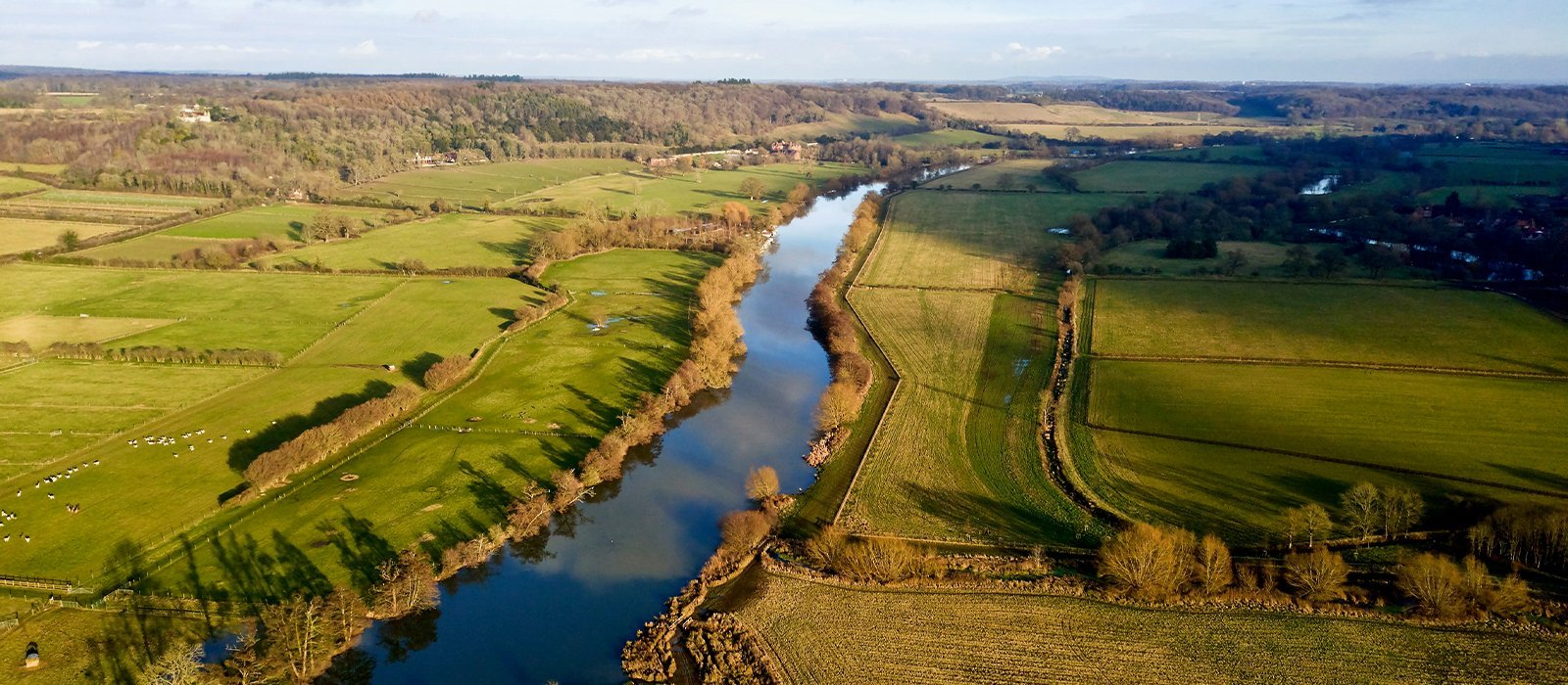 Aerial photo over The River Thames towards Reading in Berkshire countryside, UK