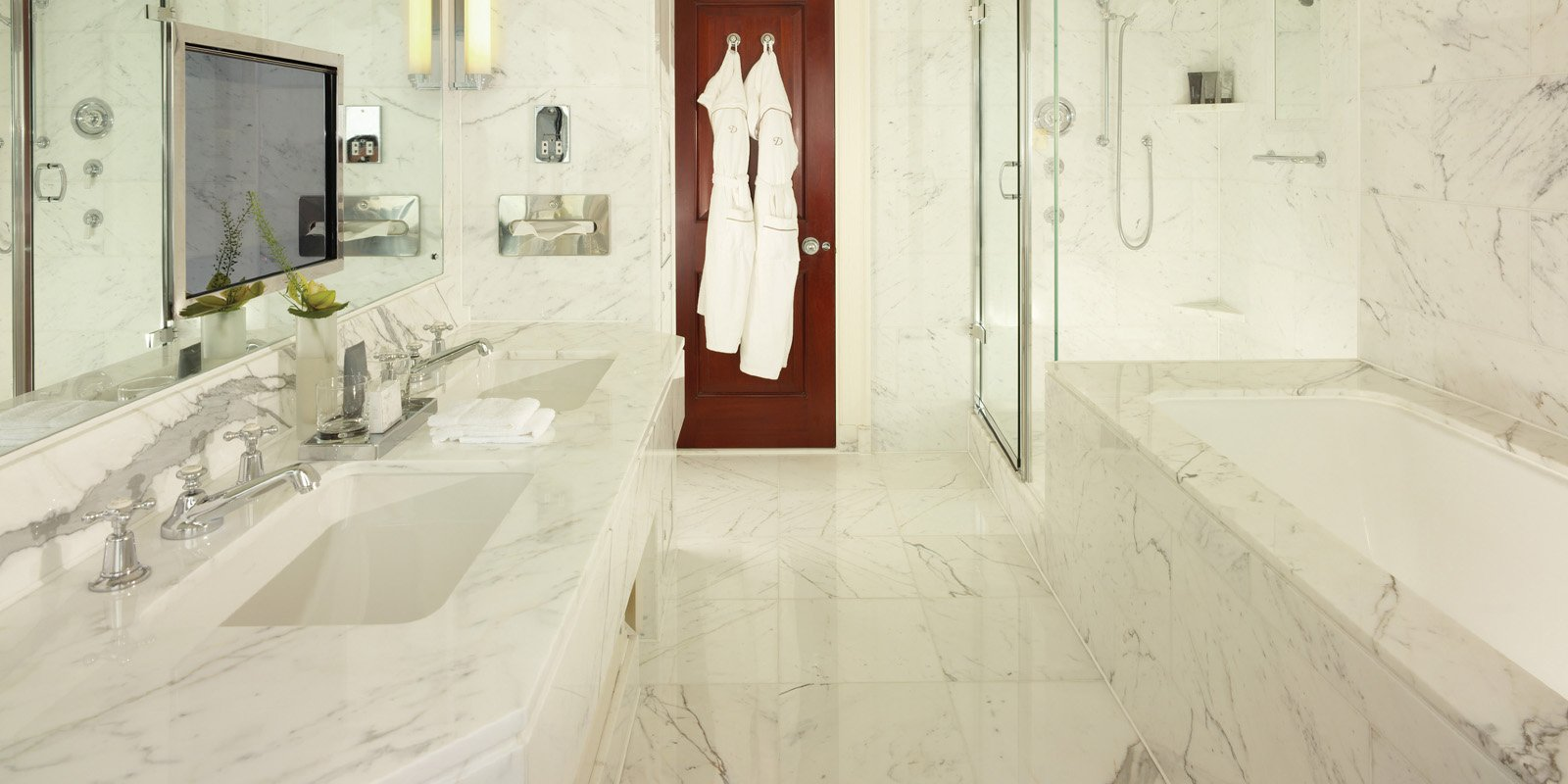 Most bathrooms enjoy natural light and have bathtubs that are specially imported and are some of the deepest, fastest-running in the world.